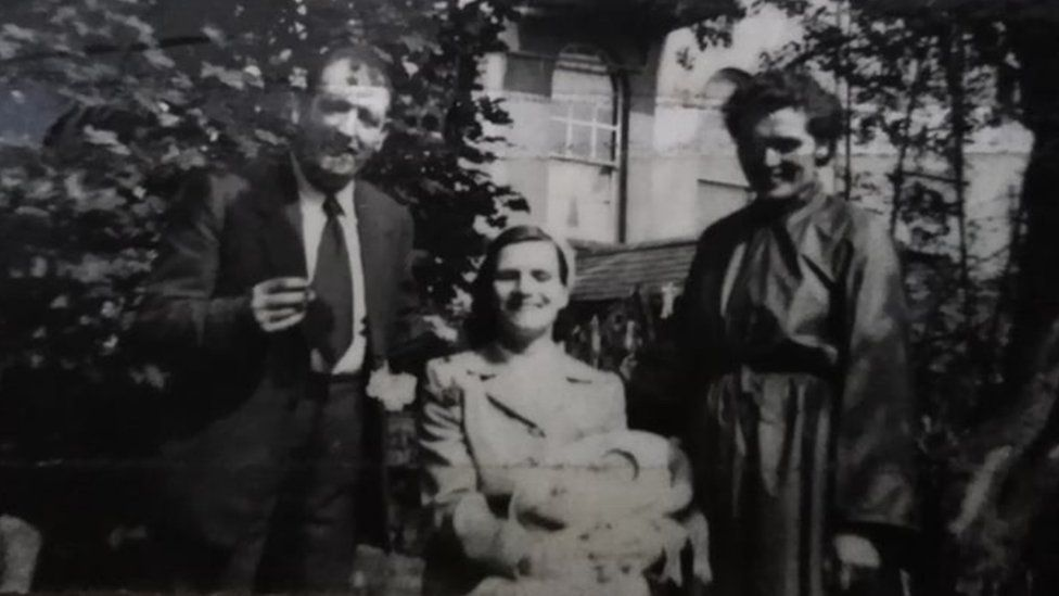 Baby Anna with her parents and her Godmother on her Christening day