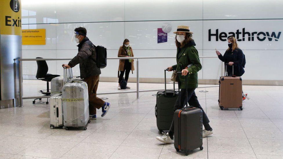 Travelers arrive at Heathrow Terminal 2