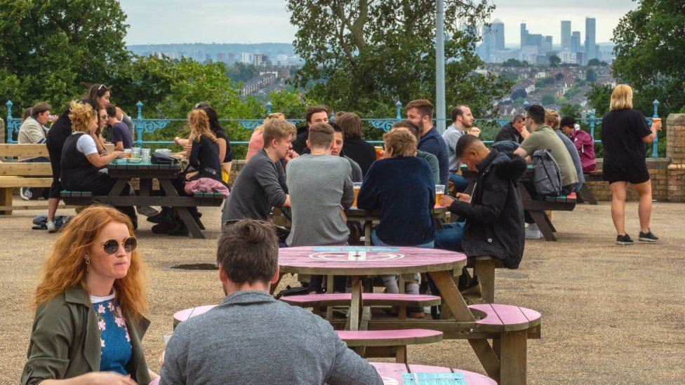 Visitors to The Terrace beer garden at Alexandra Palace on July 4, 2020 in London, United Kingdom.