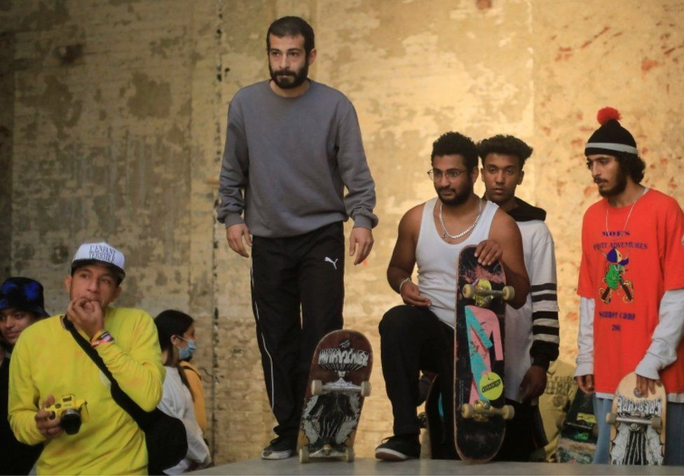 Egyptian skateboarders look on at the start of the competition.