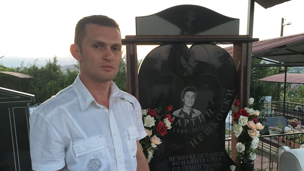 Alexander Neskovski at the grave of his his younger brother Martin