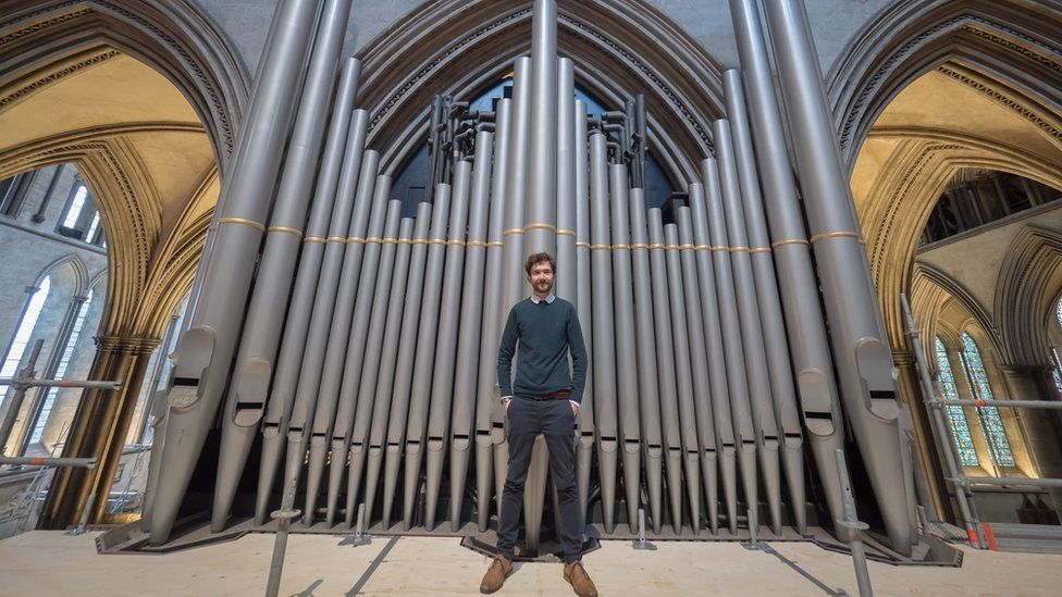 John Challenger in front of the organ