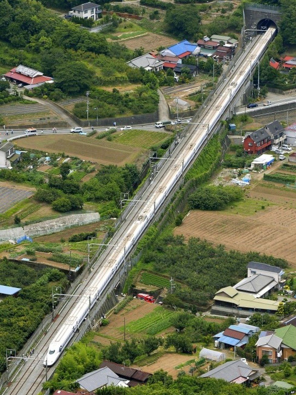 A Shinkansen bullet train stops in Odawara, west of Tokyo Tuesday, June 30, 2015.