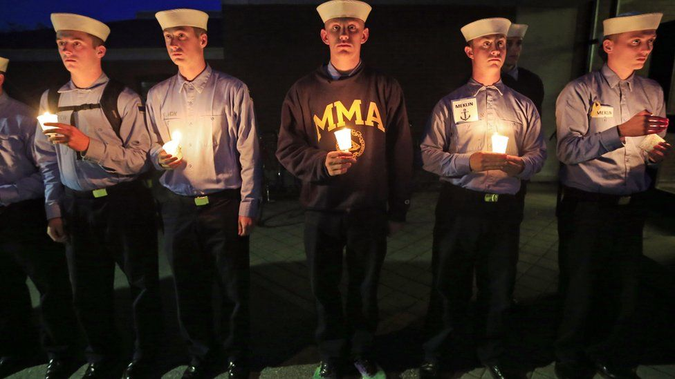 Maine Maritime Academy students attend a vigil for the crew members of El Faro on 6 October 2015