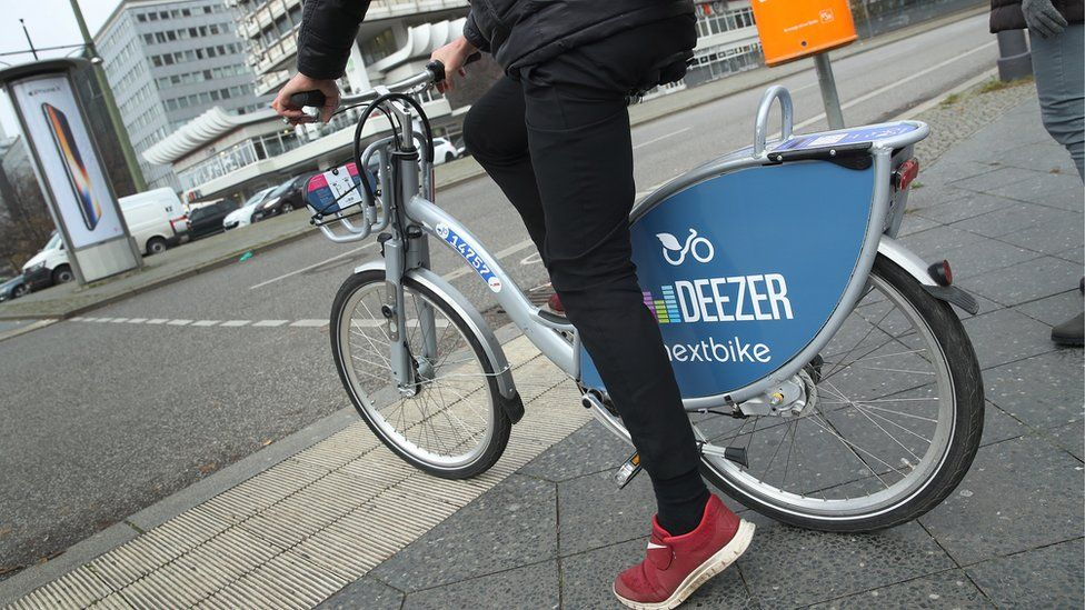 A man on a nextbike rented bicycle in Berlin