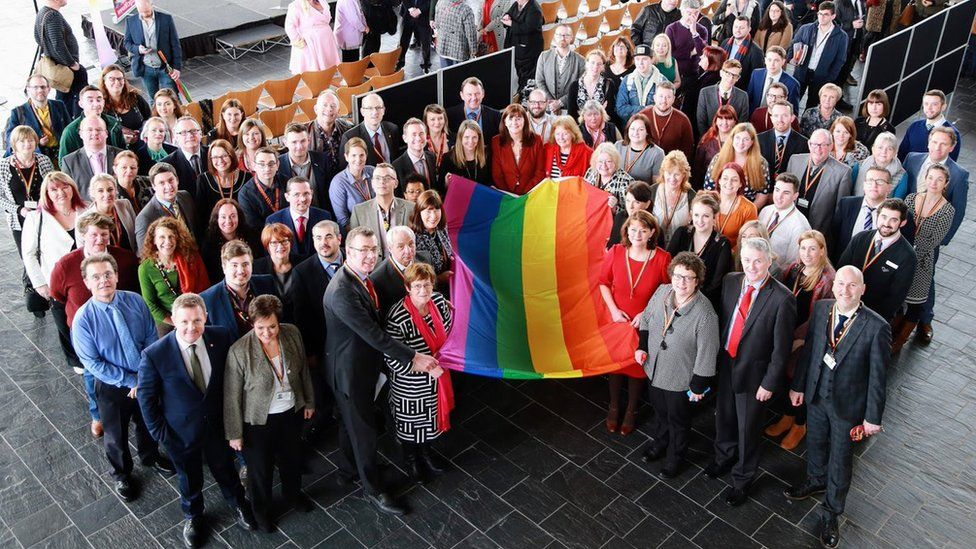 Welsh Assembly members with LGBT rainbow flag
