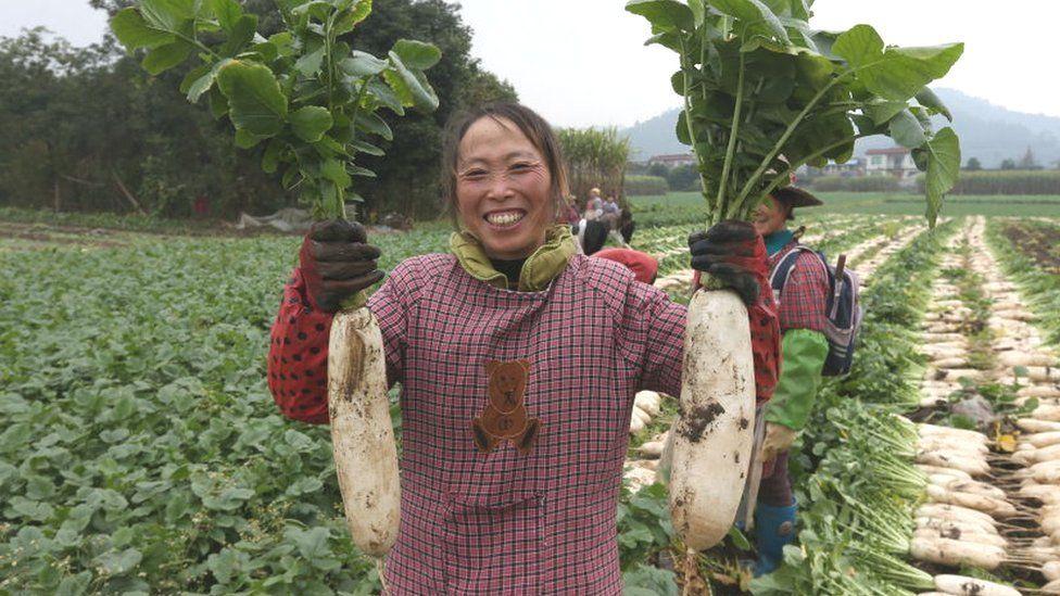 Woman holding white radishes