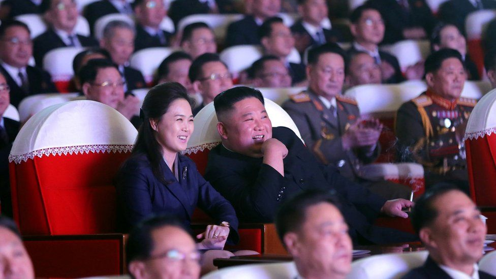North Korean leader Kim Jong Un and his wife Ri Sol Ju watch a performance that commemorated the Day of the Shining Star