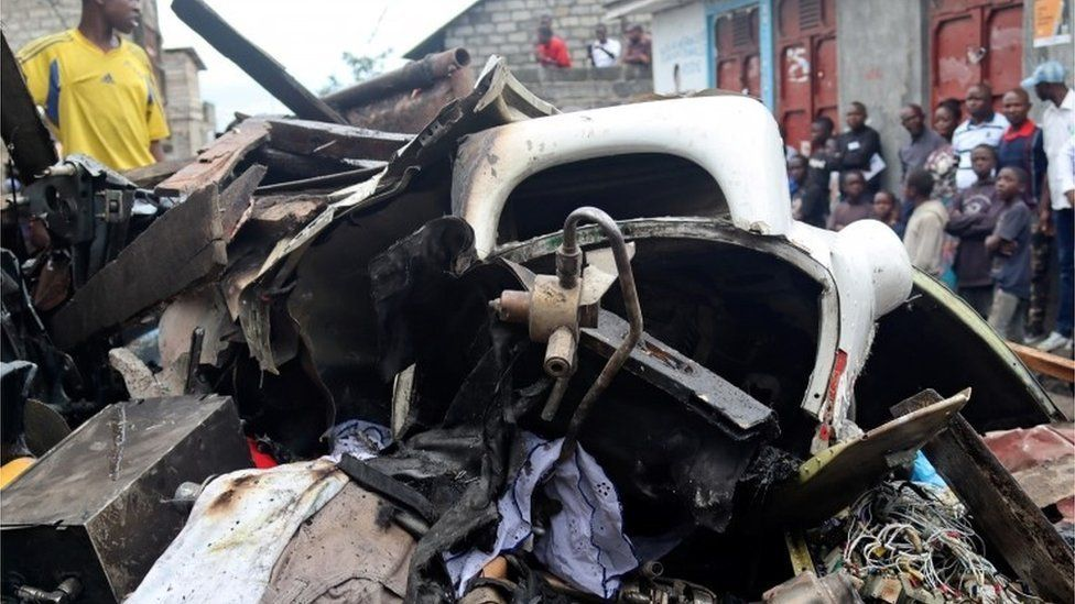 Civilians gather at the site where a Dornier 228-200 plane operated by local company Busy Bee crashed into a densely populated neighborhood in Goma, eastern Democratic Republic of Congo November 24, 2019
