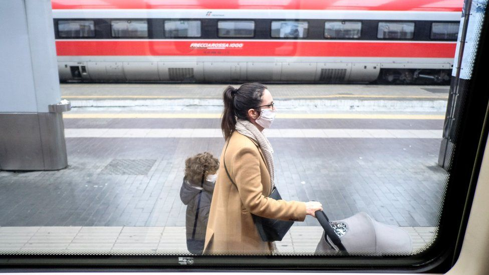 Passengers at the main station in Milan are now wearing face masks
