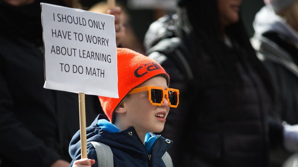 Matthew Hale, 6, of Seattle, marches with his family down 4th Avenue during the March for Our Lives rally, 24 March 2018