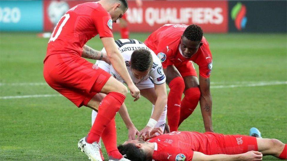 Switzerland's Fabian Schaer lies injured during the UEFA Euro 2020 qualifier against Georgia in Tbilisi, 23 March 2019