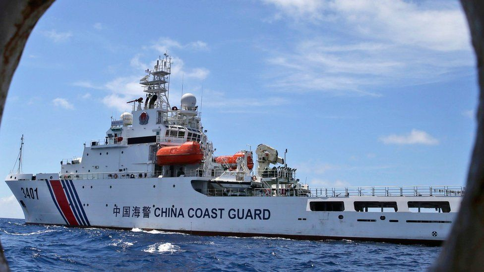 In this 29 March 2014 file photo, a Chinese Coast Guard ship attempts to block a Philippine government vessel as the latter tries to enter the Second Thomas Shoal in the South China Sea to relieve Philippine troops and resupply provisions.