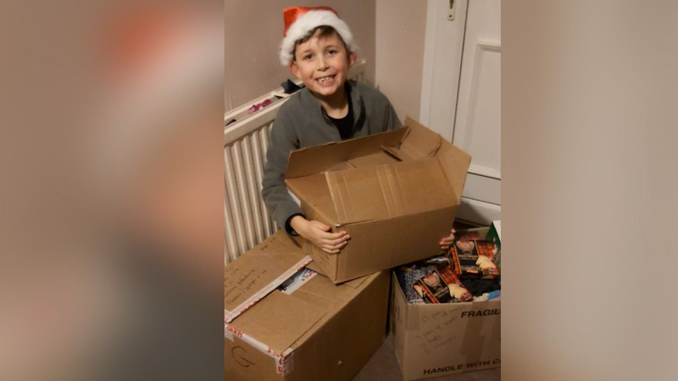 Mason with boxes for homeless collection