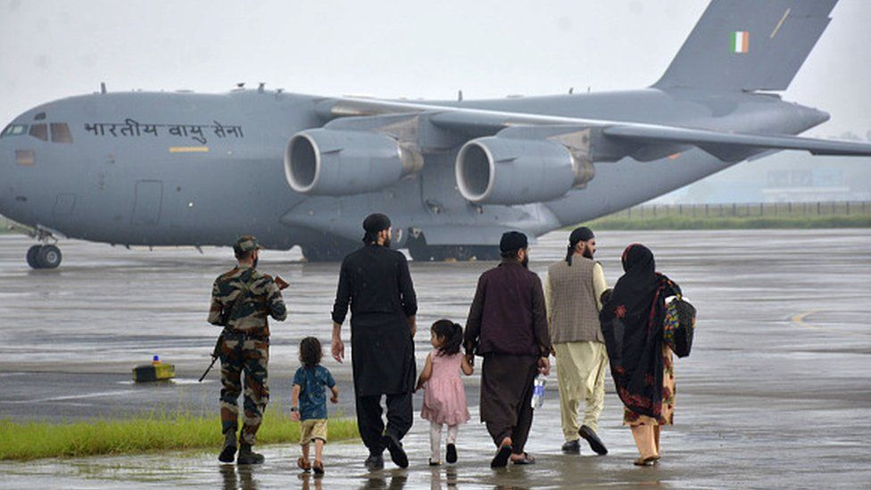 Passengers at Hindon Air Force Station after being evacuated from Kabul amid the Taliban takeover crisis, on August 21, 2021