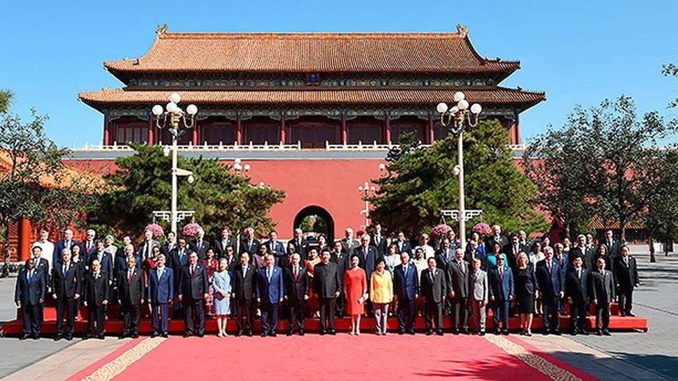 Kolya and Alexander Lukashenko pose for a photo with leaders at Beijing's WW2 commemorations