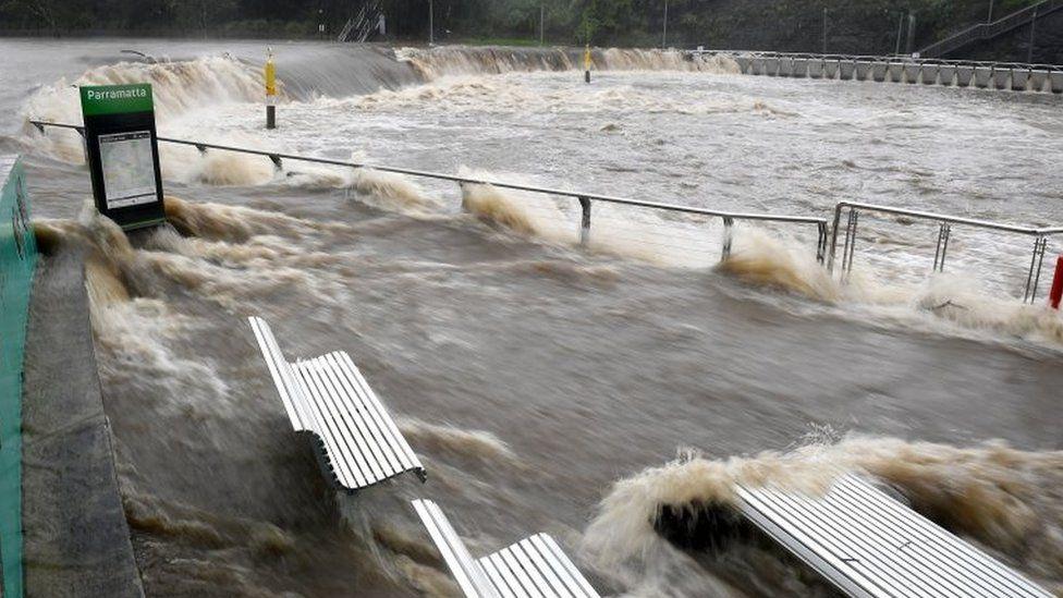 The swollen Parramatta River is seen overflowing in Sydney, Australia. Photo: 20 March 2021