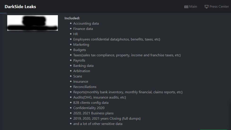 A redacted screenshot of DarkSide's website on the dark web details its success in attacking a large US manufacturer