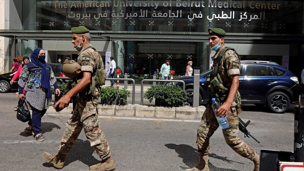 Lebanese soldiers walk past the American University of Beirut (AUB) medical centre in Beirut, Lebanon (17 July 2020)