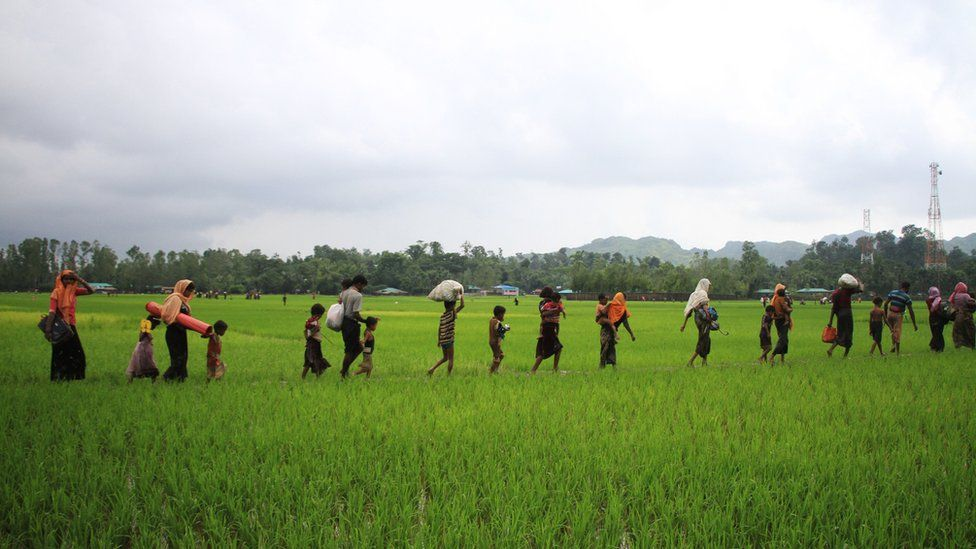 Rohingya refugees from Rakhine state in Myanmar walk along a path near Teknaf in Bangladesh on September 3, 2017.