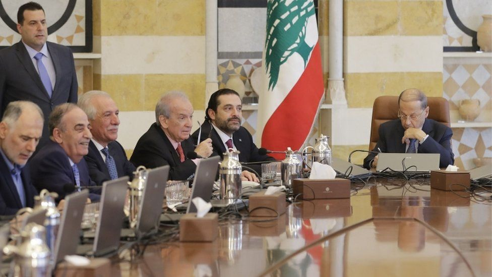 Lebanese President Michel Aoun (R) and Prime Minister Saad Hariri (2nd R) attend a cabinet meeting at the presidential palace of Baabda,