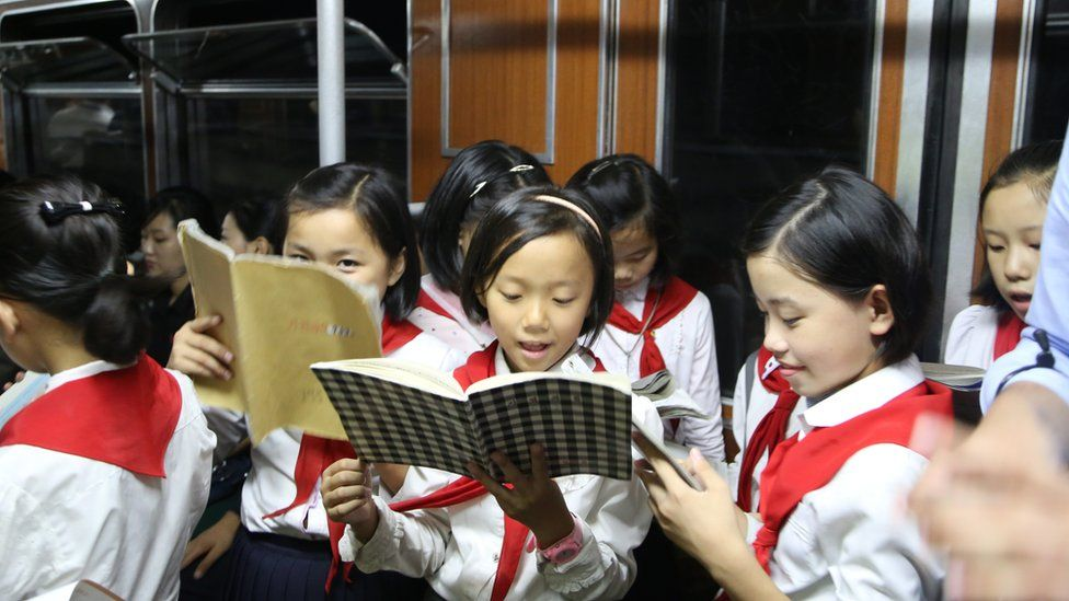 Young children in a subway carriage