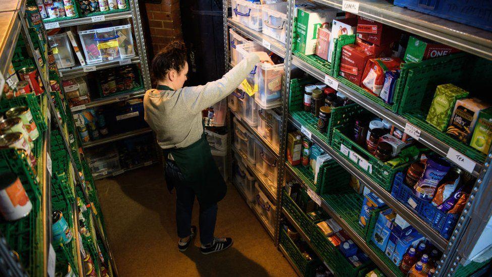 Volunteer at foodbank run by Trussell Trust