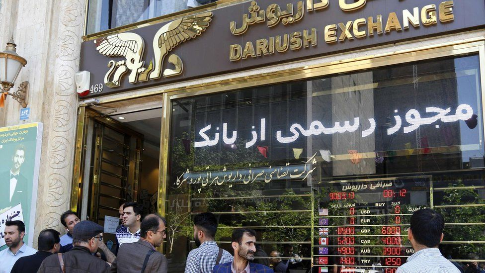 Iranians at a currency exchange shop in the capital, Tehran, 10 April 2018