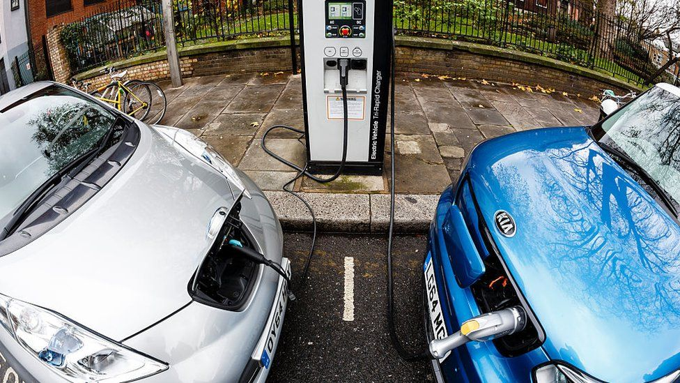 Two cars at electric charge point