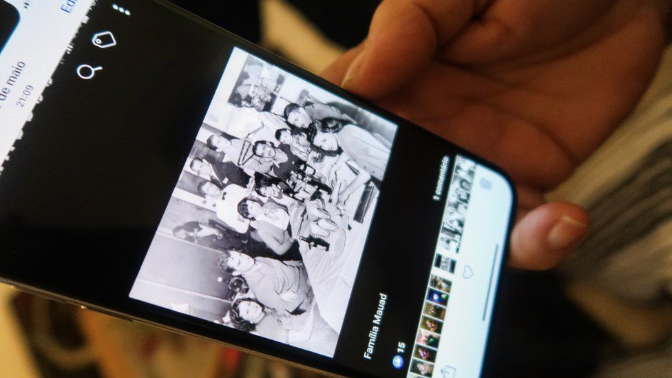 Heloisa Daher shows an old family photo on her phone
