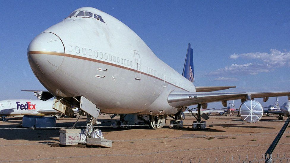 Commercial passenger airplanes and cargo aircraft are stored in the dry desert air at the Mojave Airport