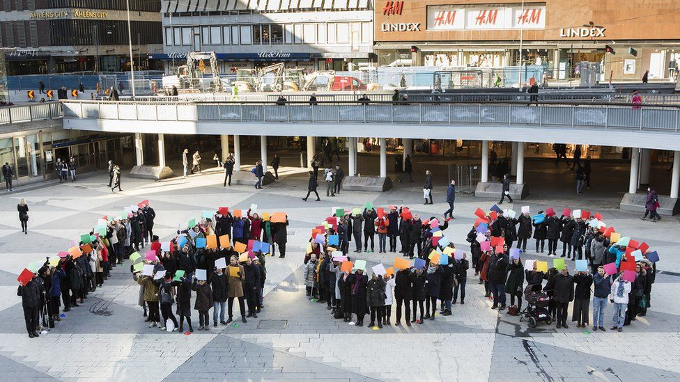 Women line up in Stockholm's central square to form the figure 1600, 15 Feb 17