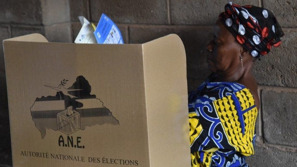 A woman prepares to cast her vote at a polling station on December 30, 2015 as people go to the polls to take part in the country's presidential and legislative in the Muslim district PK 5 of the capital Bangui
