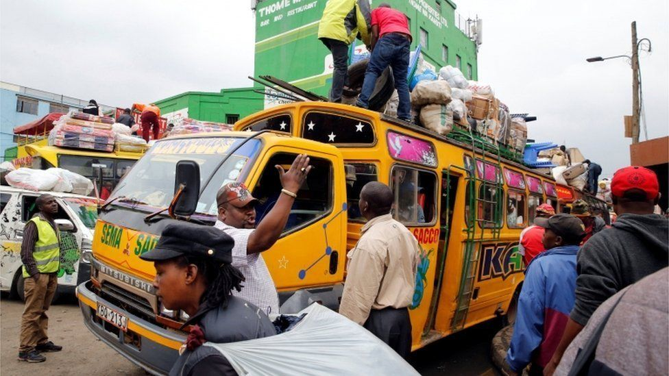 Passengers gather to use public bus transport as they travel to the countryside ahead of next week's general election in Nairobi, Kenya August 3, 2017.