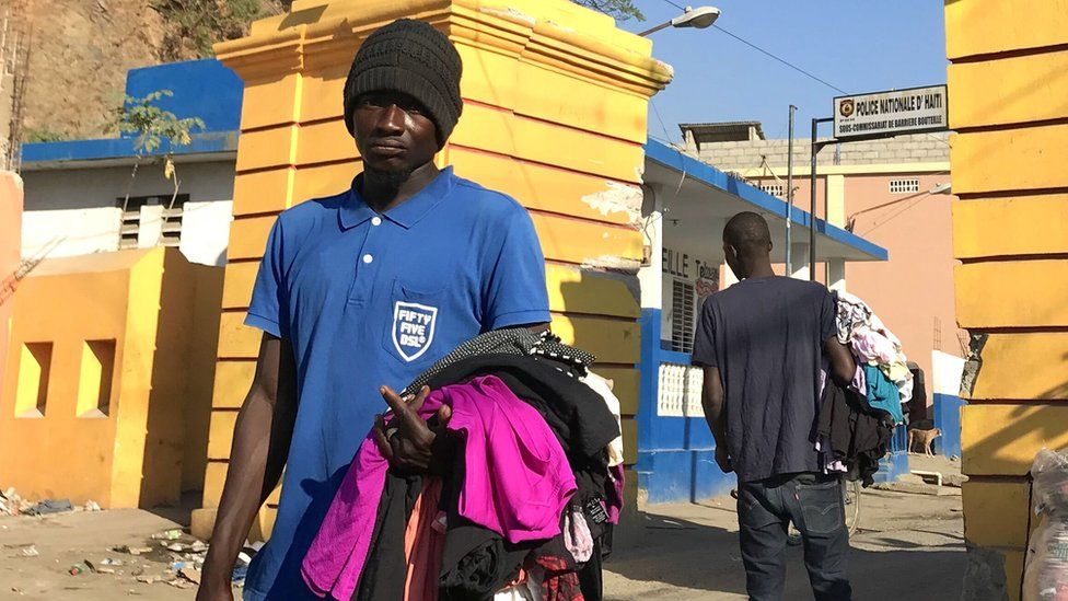 A man sells second-hand clothes on the streets in Haiti