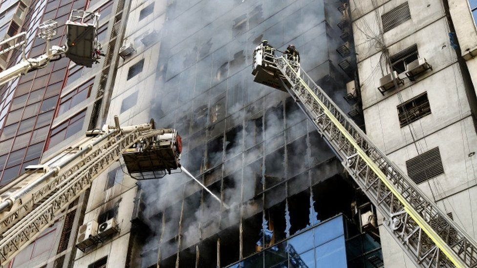Firefighters try to extinguish a fire that broke out at a high-rise building in Banani area of Dhaka, Bangladesh, 28 March 2019