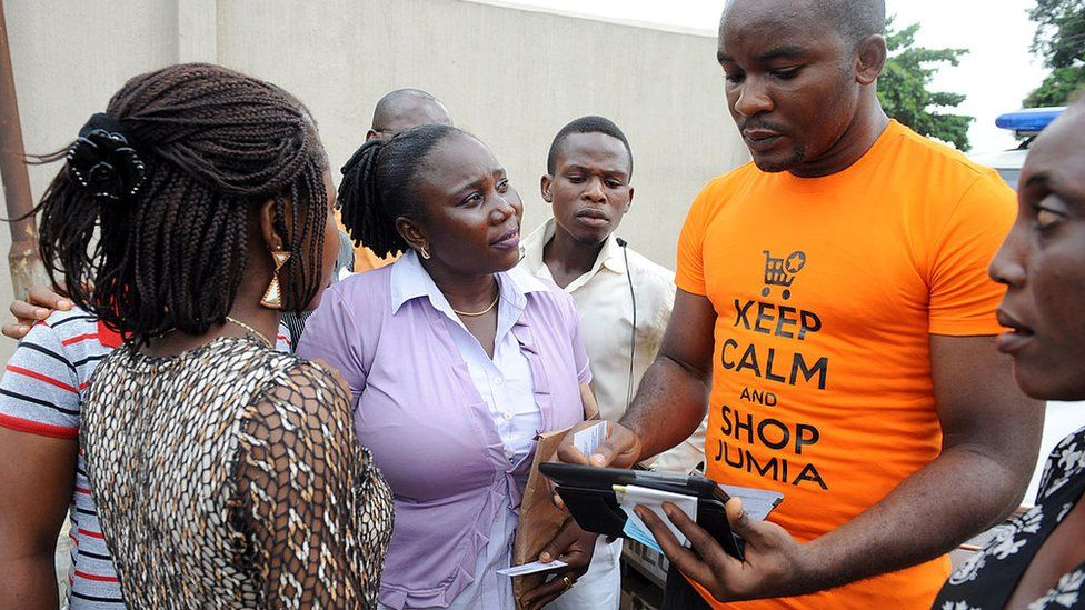 A Jumia saleman tries to market products to bystanders in Lagos on June 12, 2013.
