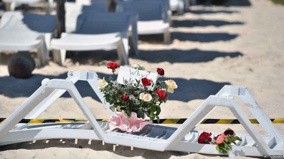 Flowers are placed at the beach next to the Imperial Marhaba Hotel on Saturday