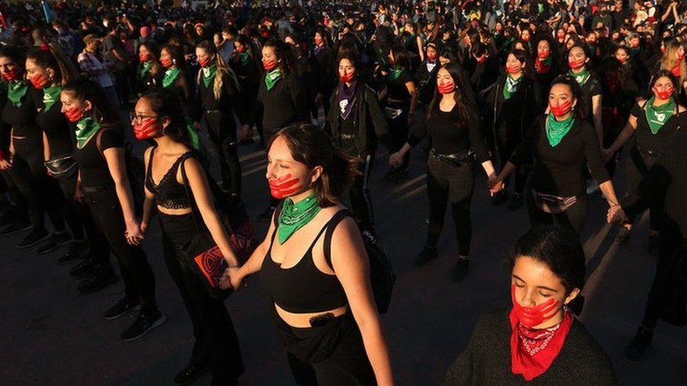 Women take part in a march to mark the International Day for the Elimination of Violence against Women, at Plaza Italia in Santiago, Chile, 25 November 2019.