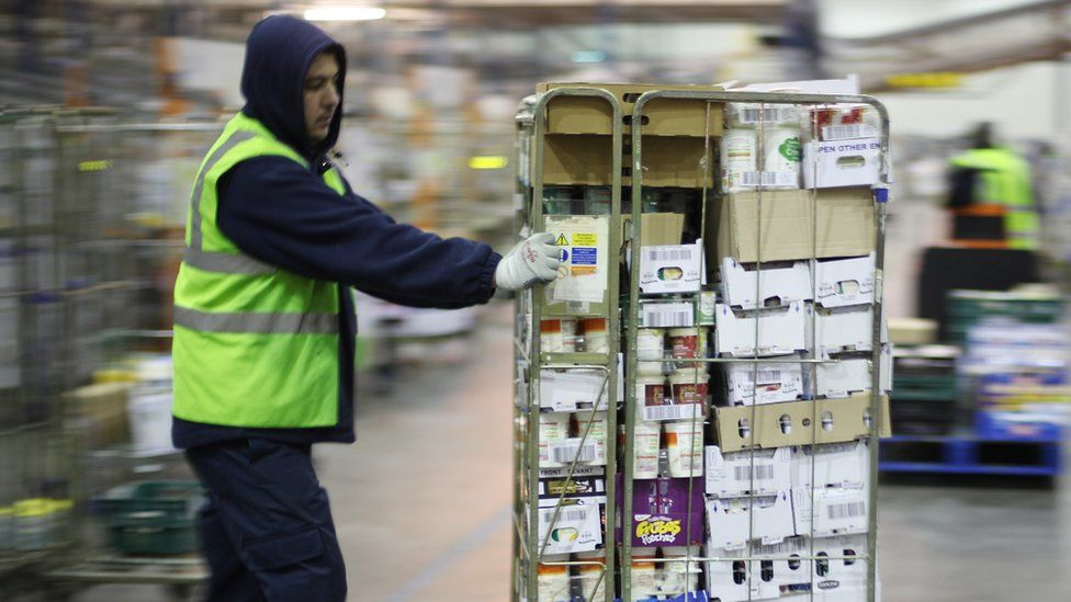 A worker in a Sainsbury's warehouse