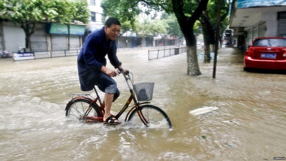 Flooded street in Xiangshan county, Zhejiang province, 11 July