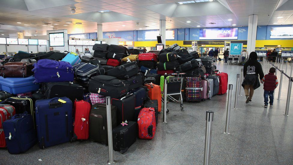 Passengers' hold luggage is stacked in the departure hall of Gatwick airport's North Terminal as severe weather has caused delays and cancellations to numerous flights from the airport on December 24, 2013 in London, England.