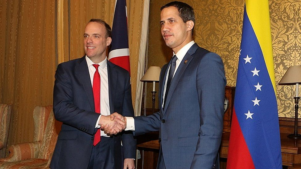 Venezuelan Opposition leader Juan Guaido (R) during a meeting with British Foreign Secretary Dominic Raab (L) at the Foreign Office in London, Britain, 21 January 2020