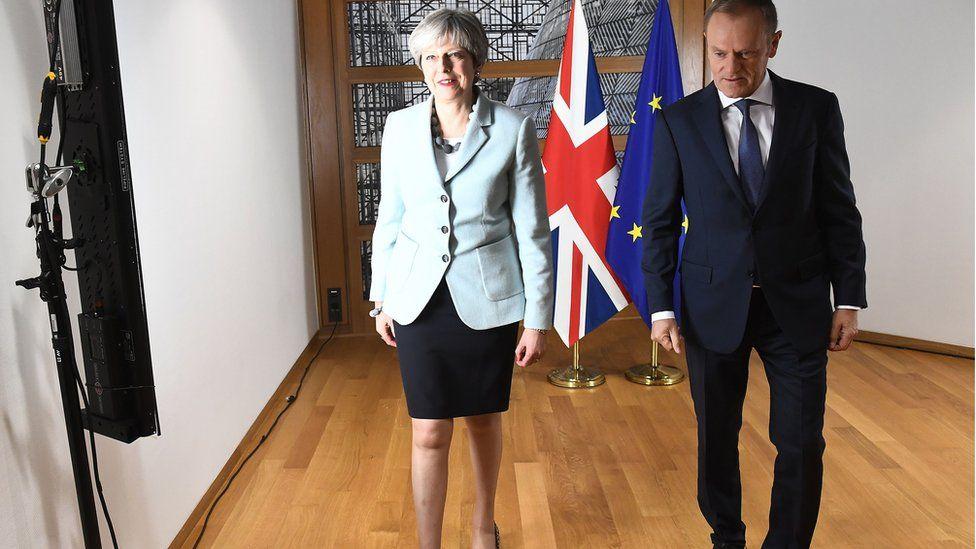 Theresa May (L) and European Council President Donald Tusk