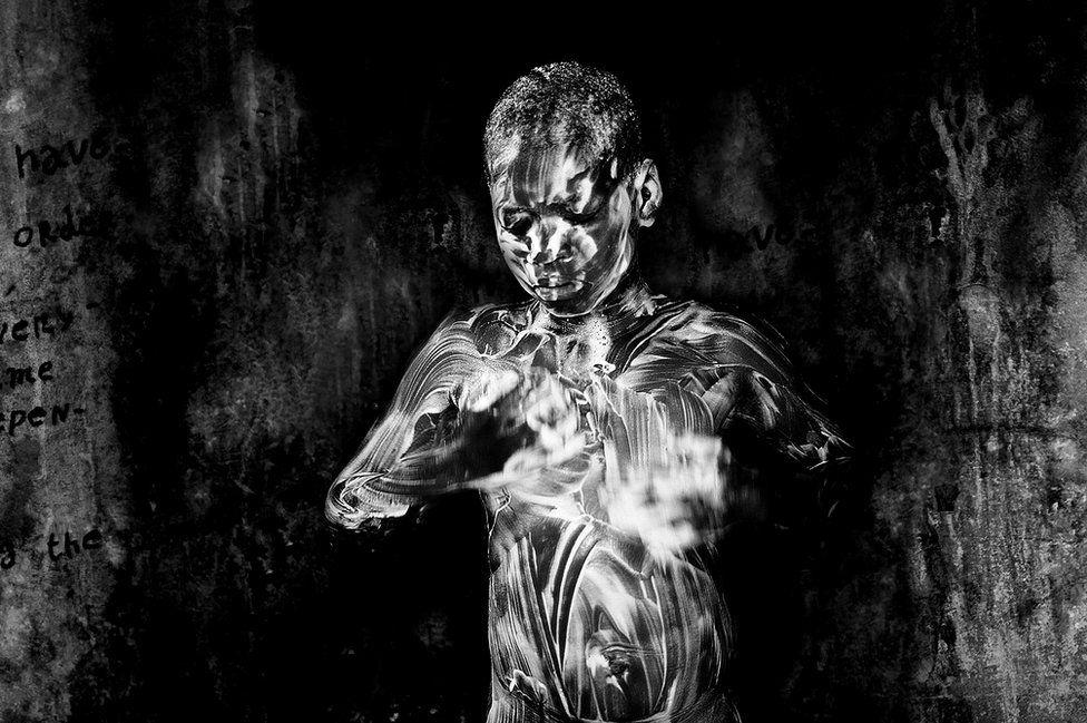 Showering by Mario Macilau