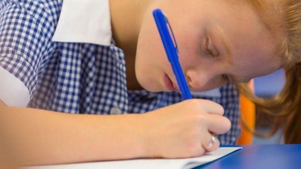 girl writing in school