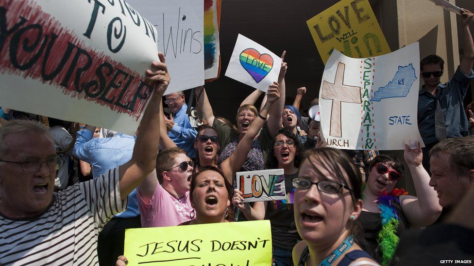 Same-sex marriage supports demonstrate on the steps of the federal courthouse during Rowan County Clerk Kim Davis's hearing on 3 September 2015 in Ashland, Kentucky