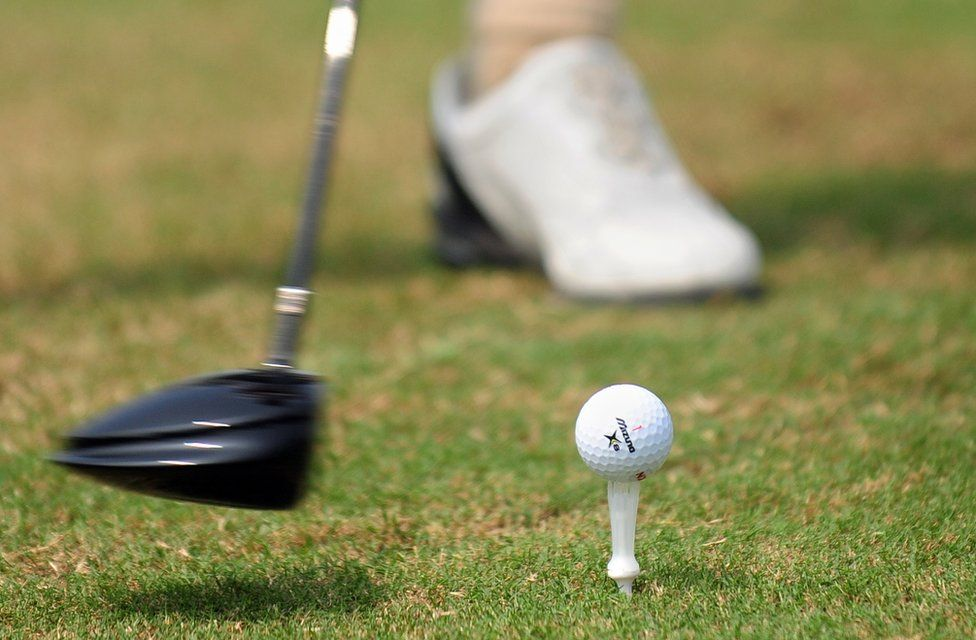 A golfer tees off at a course in Sanya on 25 October 2009 in China's southernmost tropical island province of Hainan