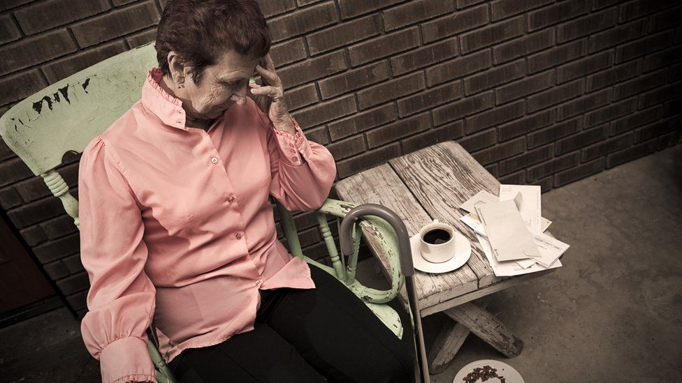 Distressed elderly person in chair