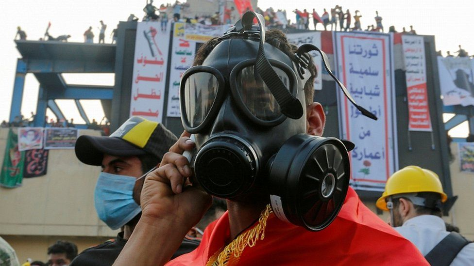 A demonstrator wears a mask to protect himself from tear gas during a protest in Baghdad, October 29, 2019